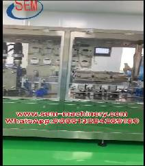 Automatic plastic ampoule liquid packing machine with a labeling machine.