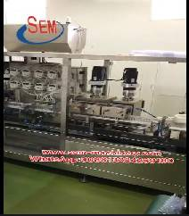 ​Automatic plastic ampoule liquid packing machine with a labeling machine.